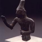 Nuraghe Flumenelongu - Alghero (SS). Bronzetto figurato di divinità benedicente con alta tiara conica (IX-VIII sec. a.C.).