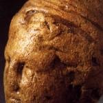 Antas - Fluminimaggiore (CA). Testa bronzeo di età punica raffigurante Sid con berretto frigio.